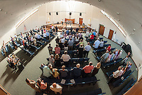 "Pastor Dan Lyle joins parishoners and guests in an opening song ""10,000 Reasons to begin the Evangelical Baptist Church dedication ceremony Sunday afternoon.  (Karen Bobotas/for the Laconia Daily Sun)"