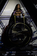 A performer plays a large taiko drum during a Mangekyo performance by Wadaiko group, DRUM TAO in Lumine 0 theatre, Shinjuku, Tokyo, Japan, Friday November 16th 2018. The Mangekyo  performance includes koto and shamisen music along with traditional  and contemporary taiko drumming and acrobatics. Organised by the Japan Tourist bureau (JTB) and the Japanese Government to entertain foreign visitors in readiness for the 2020 Tokyo Olympics. the performances run to the end of November and utilise state of the art projection mapping by TeamLab.