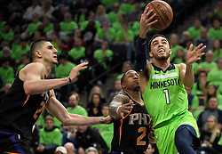 December 16, 2017 - Minneapolis, MN, USA - The Minnesota Timberwolves' Tyus Jones (1) attempts a layup, drawing a foul on the Phoenix Suns' Isaiah Canaan, in the third quarter on Saturday, Dec. 16, 2017, at Target Center in Minneapolis. The Suns won, 108-106. (Credit Image: © Aaron Lavinsky/TNS via ZUMA Wire)