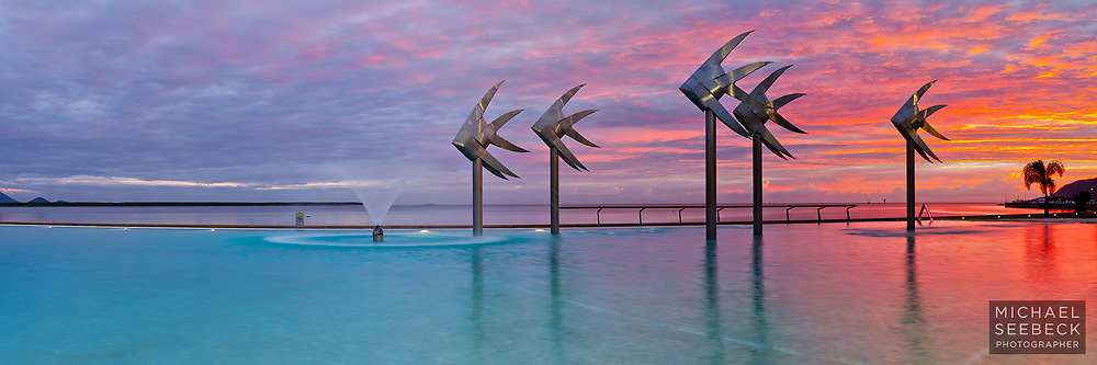 A panoramic photograph of the Cairns Esplanade Pool and Fish Sculptures at sunrise.<br /> <br /> Open Edition Print and available as Stock Image
