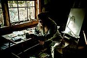 Artist Peter Moore at home in his studio in Polebridge, Montana.