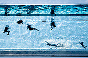 Seen from a ground perspective, swimmers enjoy the waters of the Sky Pool, a 25 metres-long transparent water pool bridging two 10-storey residential towers 35 metres above the ground, the largest freestanding acrylic pool structure in the world at EcoWorld Ballymore's new Embassy Gardens development in Nine Elms, on 3rd June 2021, in London, England.