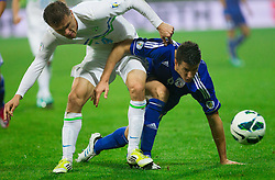 Angelis Charalampous of Cyprus  vs Zlatko Dedic of Slovenia during football match between National teams of Slovenia and Cyprus in 3rd Round of Group E of FIFA World Cup 2014 Qualification on October 12, 2012 in Stadium Ljudski vrt, Maribor, Slovenia. (Photo By Vid Ponikvar / Sportida)