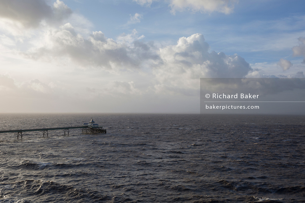 The Grade 1 listed Victorian-era Clevedon Pier and a stormy sea, on 29th December 2017, in Clevedon, North Somerset, England.