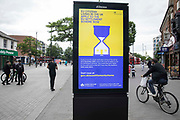 An advertisement for the EU Settlement Scheme is displayed on 11th June 2021 in Hounslow, United Kingdom. The UK government is using such advertisements to urge EU citizens living in the UK by 31st December 2020 to apply to the EU Settlement Scheme by 30th June 2021.
