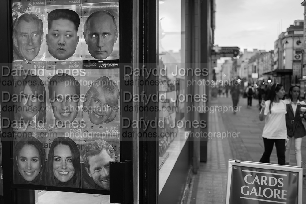 Masks in a shop window, The Strand, London,  23 August 2018