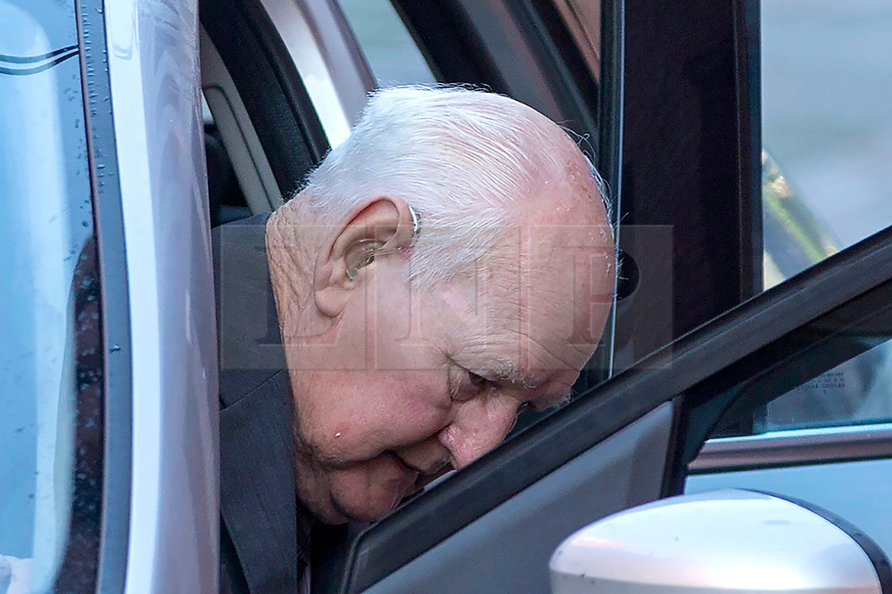 """© Licensed to London News Pictures. 10/10/2018. Leeds UK. Former police officer 83 year old David Lomax arrives at Leeds Crown Court this morning. Lomax is accused of raping a woman in 1978 because she was unable to pay a fine. Lomax was in his 40's at the time & worked as a warrant officer with West Yorkshire Police. It is alleged that David Lomax had gone to the woman's address two weeks before the alleged offence to collect payment but had agreed to give her extra time to find the money. He then allegedly returned to on the 20th October but the woman was still unable to pay. The court heard Mr Lomax had told the woman he would have to take her to the police station but then put his hand on her shoulder and said: """"Well we could solve this."""" He then allegedly led the woman into her bedroom & raped her against a wall before leaving. The court heard the woman reported it to police several days later and a DNA sample was retrieved from a towel. Jurors at Leeds Crown Court were told Mr Lomax, was charged after his DNA profile was matched in a cold case review in 2016. Photo credit: Andrew McCaren/LNP"""