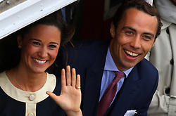 Pippa and James Middleton on the river during the Diamond Jubilee Pageant on the River Thames in London.
