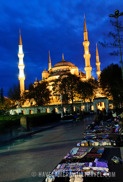 Street vendors lay out their wares in front of the Blue Mosque (Sultan Ahmed Mosque (Turkish: Sultanahmet Camii)), a Muslim (Sunni) Mosque in the center of Istanbul's old town district of Sultanahmet. It was commissioned by Sultan Ahmed I and completed in 1616,
