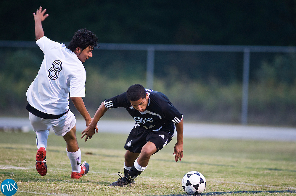Robinson's Cristhian Reyes and Concord's Osvaldo Arellano fight for the ball during South Piedmont Conference soccer action Tuesday night at Jay M. Robinson High School in Concord. The game ended in a scoreless tie.  (Photo by James Nix)