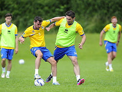 Bristol Rovers' Michael Smith battles for the ball with Bristol Rovers' Jim Patterson - Photo mandatory by-line: Joe Meredith/JMP - Tel: Mobile: 07966 386802 24/06/2013 - SPORT - FOOTBALL - Bristol -  Bristol Rovers - Pre Season Training - Npower League Two