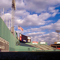 1987, Famous Fenway Park's Green Monster wall, before the seats were installed on top in 2003.  Note the ladder for grounds keepers to climb up and retrieve home run balls out of the net protecting Landsdowne Street.  Opened April 20, 1912