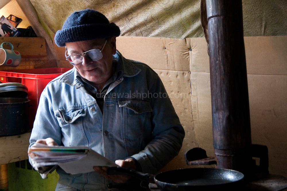 Poet and Tara protestor Kieron Murray, also known as Kyrie Murray, reading poetry in a hut at Tara...