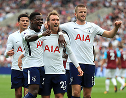 Tottenham Hotspur's Christian Eriksen (centre) celebrates scoring his side's third goal of the game during the Premier League match at the London Stadium.