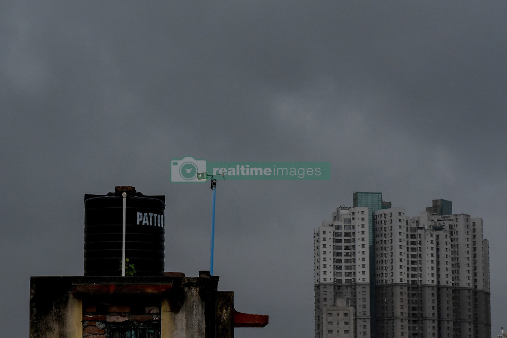 May 3, 2019 - Kolkata, West Bengal, India - Torrential rain clouds covered the cityscape of Kolkata followed by heavy gust of winds as the Super Cyclone FANI makes her way towards the metropolitan. It is predicted to make contact with the city late in the evening with expected wind speed of around 120kph. Authorities and civilian are taking precaution to tackle this massive storm. (Credit Image: © Debarchan Chatterjee/ZUMA Wire)