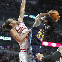 26 March 2012: Denver Nuggets forward Kenneth Faried (35) goes to the basket against Chicago Bulls center Joakim Noah (13) during the Denver Nuggets 108-91 victory over the Chicago Bulls at the United Center, Chicago, Illinois, USA. NOTE TO USER: User expressly acknowledges and agrees that, by downloading and or using this photograph, User is consenting to the terms and conditions of the Getty Images License Agreement. Mandatory Credit: 2012 NBAE (Photo by Chris Elise/NBAE via Getty Images)