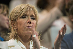 The wife of French presidential election candidate for the En Marche ! movement Emmanuel Macron, Brigitte Trogneux gestures during a campaign meeting on April 17, 2017 at the Bercy Arena in Paris. Macron plans his biggest rally yet at the Bercy sports and concert hall, a venue with a capacity of 20,000. The location near the economy ministry serves as a reminder that the relatively inexperienced Macron held the key economy portfolio for two years under his mentor Hollande. Photo by ABACAPRESS.COM  | 589639_010 PAris France