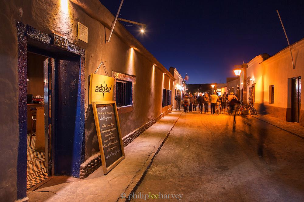 Entrance to Adobe restaurant, San Perdo de Atacama street at night, Atacama Desert, Chile, South America