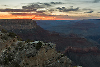 A colorful sunset fills the western sky above the Grand Canyon as seen from Yavapai Point