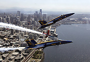 Always a thrill at Seafair time, the Blue Angels fly over downtown Seattle and Elliott Bay. (Greg Gilbert / The Seattle Times)