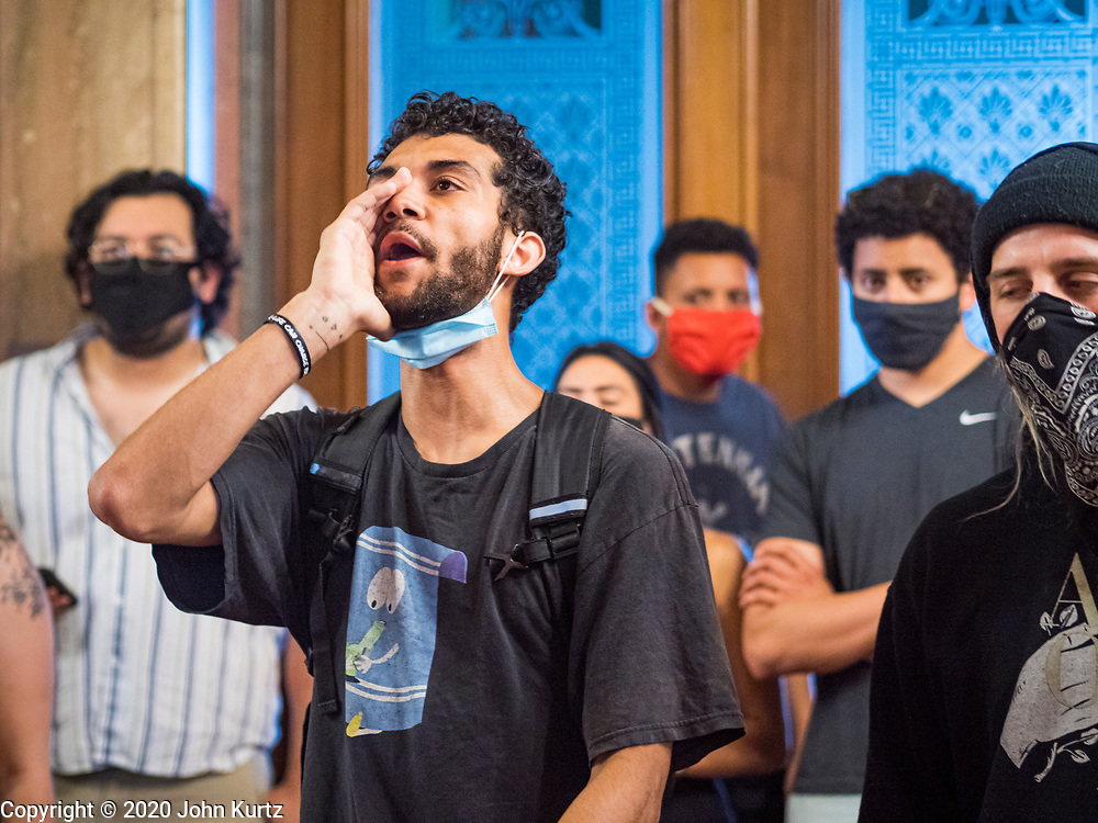 12 JUNE 2020 - DES MOINES, IOWA: Black Lives Matter supporters chant in the hallway in front of the Governor's Reception Room in the Iowa capitol. About 75 activists from Black Lives Matter came to the Iowa State Capitol in Des Moines Friday to talk to Iowa Governor Kim Reynolds. They've been trying to meet with Gov. Reynolds all week. She made time for them Friday and met with 5 representatives of the organization without any media in the room. They wanted to talk to her about police violence against African-Americans and racial disparities in Iowa's justice system. While the 5 met with the Governor, the remaining activists picketed the hall in front of her office and chanted.     PHOTO BY JACK KURTZ