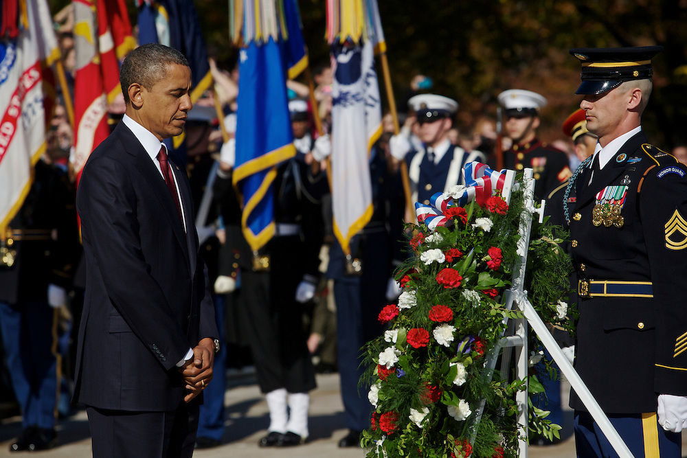 ARLINGTON, VA - NOVEMBER 11: U.S. President Barack Obama lays a wreath in front of the Tomb of the Unknowns during the Presidential Wreath-Laying Ceremony at Arlington National Cemetery on November 11, 2012 Arlington, Virginia.