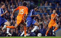 Photo: Paul Thomas.<br /> Chelsea v Barcelona. UEFA Champions League, Group A. 18/10/2006.<br /> <br /> Didier Drogba (Blue) of Chelsea makes a break down field.