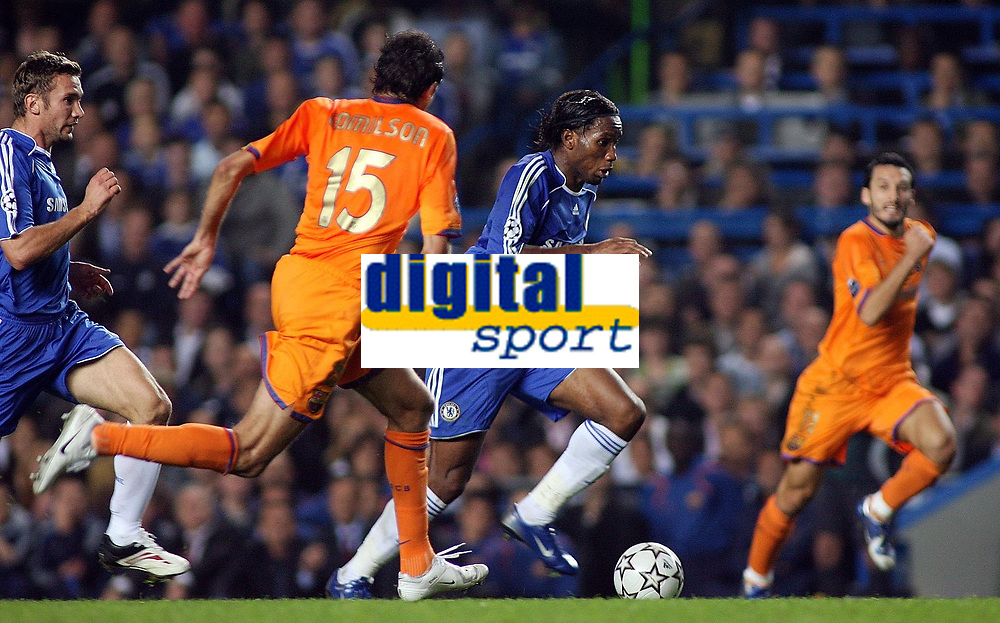 Photo: Paul Thomas.<br /> Chelsea v Barcelona. UEFA Champions League, Group A. 18/10/2006.<br /> <br /> Didier Drogba (Blue) of Chelsea makes a break down field.