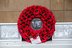 Staff take part in the two minute silence for VE day at the War Memorial at Waverley Station.