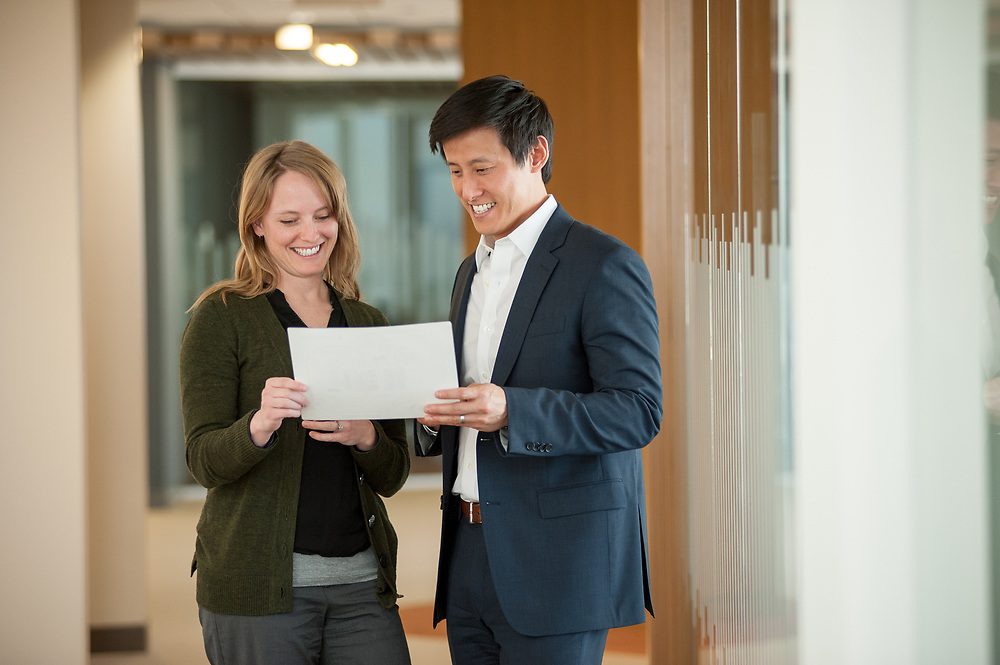 Business lifestyle image of a man and a woman reviewing a document in. an office.