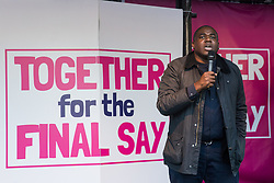 London, UK. 19 October, 2019. David Lammy, Labour MP for Tottenham, addresses hundreds of thousands of pro-EU citizens at a Together for the Final Say People's Vote rally in Parliament Square as MPs meet in a 'super Saturday' Commons session, the first such sitting since the Falklands conflict, to vote, subject to the Sir Oliver Letwin amendment, on the Brexit deal negotiated by Prime Minister Boris Johnson with the European Union.