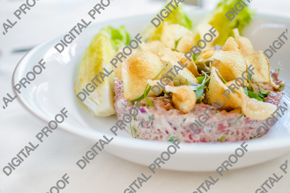 Tuna Tartare served on white dish with chips