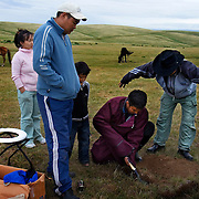 Mongolian guide Tulga instructs his crew to dig a bigger toilet for the foreign tourists..Autistic child Rowan, 5, rides a horse in Mongolia, accompanied by his parents Rupert and Kristin, their Mongolian guide Tulga, his six-year-old son Bodibilguunson and an American documentary TV crew. .Rowan's parents believe horses and shamans can unlock their sonís autistic mind. This is their journey of discovery across Mongolia on horseback. .The story is published by the Sunday Times and accompany text by Tim Rayment.