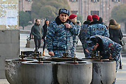 Armenian policemen drink water at a fountain outside Armenian Government premises in the Republic Square, Armenian capital Yerevan on Sunday, Dec 13, 2020. Additional police forces are concentrated around government building as tens of thousands of opposition supporters have marched during november through the Armenian capital to call for the resignation of the country's prime minister because of his handling of the conflict with Azerbaijan over Nagorno-Karabakh. (VXP Photo/ Vudi Xhymshiti)