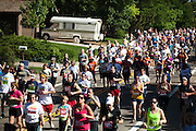 Runners compete in the 2012 Bolder Boulder 10K road race in Boulder, Colorado.