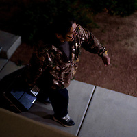 Roland Edaakie hauls a case with the results from the Wingate polling station into the McKinley County Clerks Office in Gallup Tuesday.