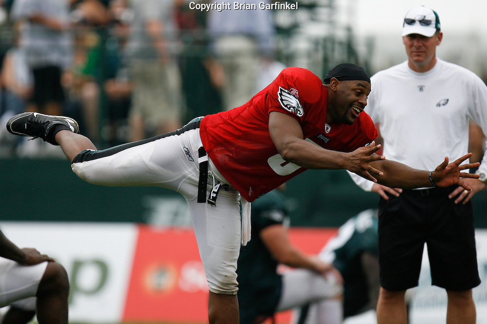 Bethlehem, Pennsylvania - Quarterback Donovan McNabb kids around while stretching after the morning practice at the Eagles Training camp at Lehigh University.