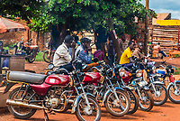 Motorcycle taxi drivers waiting for a fare, Hoima, Uganda.