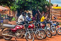 Motorcycle taxi drivers waiting for a fare, Hoima, Uganda.