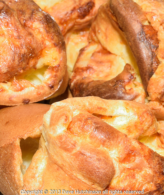 A close-up image of crisp and steamy homemade Cheese Popovers.
