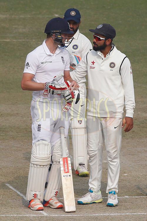 Virat Kohli Captain of India enquiry about well being of Chris Woakes of England during day 4 of the third test match between India and England held at the Punjab Cricket Association IS Bindra Stadium, Mohali on the 29th November 2016.<br /> <br /> Photo by: Deepak Malik/ BCCI/ SPORTZPICS