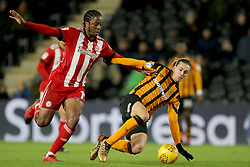 Hull City's Jackson Irvine and Brentford's Romaine Sawyers battle for the ball