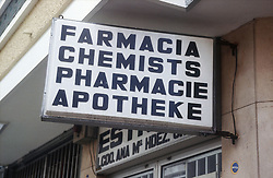 Multilingual sign for chemist shop in English; German; French and Spanish,