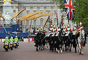 © Licensed to London News Pictures. 06/06/2012. London, UK. The changing of the guard ceremony takes place amongst the work. Workmen begin the task of deconstructing the stages and scaffolding platforms put in place for the celebrations.  The Royal Jubilee celebrations. Great Britain is celebrating the 60th  anniversary of the countries Monarch HRH Queen Elizabeth II accession to the throne this weekend Photo credit : Stephen Simpson/LNP