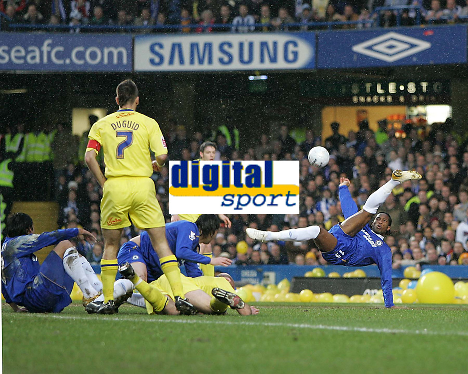 Photo: Lee Earle.<br /> Chelsea v Colchester United. The FA Cup. 19/02/2006. Chelsea's Didier Drogba (R) tries an overhead kick.