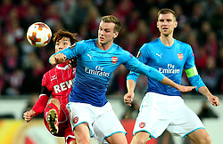 Yuya Osako of Cologne challenges Rob Holding of Arsenal - Mandatory by-line: Robbie Stephenson/JMP - 23/11/2017 - FOOTBALL - RheinEnergieSTADION - Cologne,  - Cologne v Arsenal - UEFA Europa League Group H