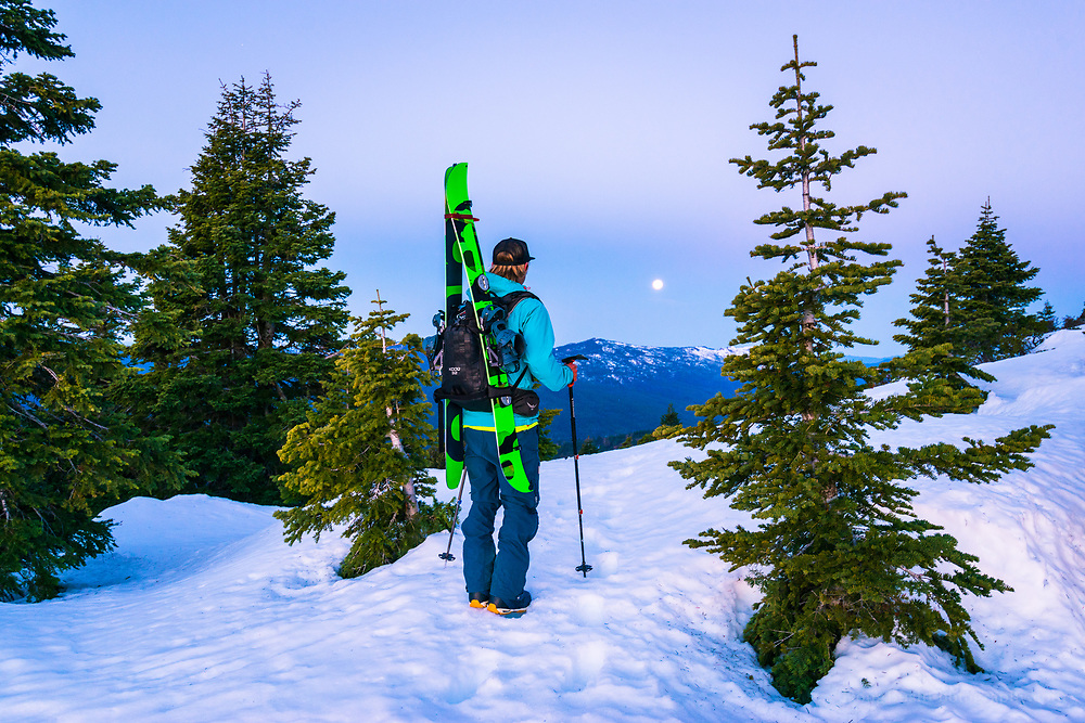 Hiking up Hull Mountain early in the morning with skis on our back because the snow was too icy and the terrain too steep make it to the top without our boots.