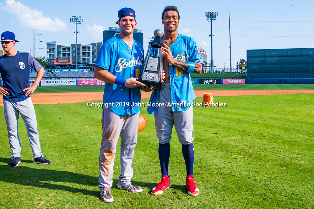 Amarillo Sod Poodles infielder Hudson Potts (10) and Amarillo Sod Poodles outfielder Buddy Reed (12) poses with the trophy after the Sod Poodles won against the Tulsa Drillers during the Texas League Championship on Sunday, Sept. 15, 2019, at OneOK Field in Tulsa, Oklahoma. [Photo by John Moore/Amarillo Sod Poodles]