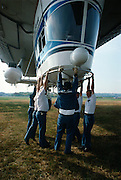 Crew holds on the Gondola of the Goodyear Blimp to keep it on the ground at Teterborough, New Jersey.