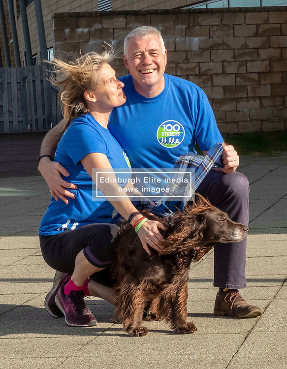 Pictured: Jenny anjd Scott Hastings with Parkewr the dog<br />